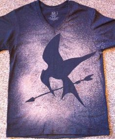 Place a cut-out on a shirt and then spray bleach around it. Too easy. I'm SO doing this!!!