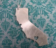 Heart Your State Necklaces. It would look cool with our wonderful boot state.