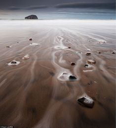 Tidal flow: Sea foam at Bass Rock, Firth of Forth, Scotland by Stuart Low