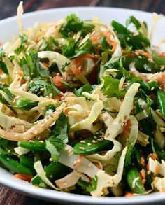 Cabbage Salad Ingredients: 8 ounces snap peas 4 cups shredded cabbage 1 shredded carrot 2 green onions, diced 1/4 cup chopped fresh cilantro Ponzu Dressing Ingredients: 1/4 cup Ponzu sauce 1 tablespoon sesame seeds 1 teaspoon garlic powder 2 teaspoons sesame oil