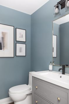 Powder Room - A simple Powder Room that packs a punch with Sherwin Williams SW 6221 Moody Blue. Blue Bathroom Paint, Bathroom Wall Colors, Light Blue Bathrooms, Powder Room Paint, Blue Powder Rooms, Blue Wall Colors, Room Paint Colors, Small Toilet Room, Light Blue Walls