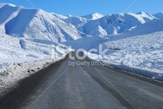 A road, the Great Alpine Highway, leads through the snow into the. Deep Photos, Image Now, National Parks, Royalty Free Stock Photos, Led, Mountains, Photography, Travel, Photograph
