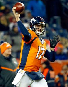 Denver Broncos quarterback Brock Osweiler (17) warms up prior to an NFL football game against the New England Patriots, Sunday, Nov. 29, 2015, in Denver.