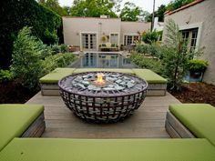 Fire and Water  In this elegant design, Jamie Durie created a vacation-at-home destination: a lounge area around a gabion fire pit with a gorgeous view of the pool.