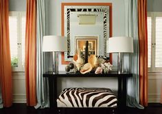 Orange-Pale-Blue-Interior    This vignette brings the ocean inside with the use of shells on the table.  The zebra ottoman introduces an African flare.  Kind of a juxtaposition of styles but it works.  Where's the turquoise you ask…I know…so we'll just say there's a drop of blue in the wall color!