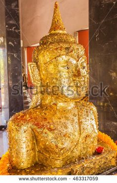 Phuket, Thailand - Sept 12, 2015: Strange Buddha statue at Pratong temple or Phra-phud temple. it is Buddha statue appear up from ground with half body. it is well-known destination for many tourists