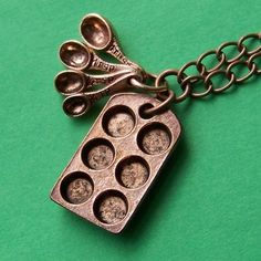 Etsy. Antiqued Copper Bakers Charm Necklace with Miniature Cupcake Baking Pan and Tiny Measuring Spoons. #etsy #accessories #charm #necklace #fashion #baking #food #gift $16 jewelry