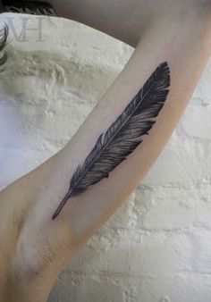 feather tattoo. this is like Dave Grohl's