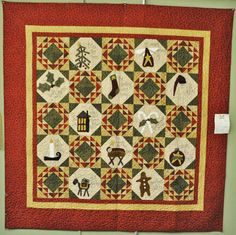 This beautiful quilt is currently hanging in the classroom at the shop. Pieced by Marilyn Wozniak & quilted by Peach Pie Quilting, this Christmas quilt is called Home for the Holidays. Pattern and fabric designed by Primitive Gatherings. I just love...love...love Primitive Gatherings :)