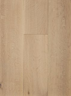 Muted white color on clean rift and quartersawn white oak. Smooth surface with satin finish.