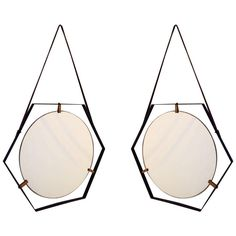 Pair Of Hexagonal 50's Mirrors | From a unique collection of antique and modern wall mirrors at http://www.1stdibs.com/furniture/mirrors/wall-mirrors/