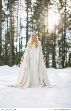 A white wonderland inspired wedding in the forest with a mystical feel.