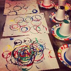 Olympic Craft for Kids: Create your very own Olympic art with your kids during the Olympic games. Supplies: paper or canvas, Styrofoam or plastic cups, paper plates, paint: red, blue, green, yellow and black.