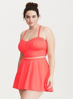 933827f7266 Major ruching adds flattering flare to the lightly lined coral cups on this  bikini top