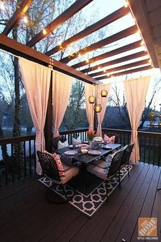 I love the look of this outdoor living space! The rug brings a level of warmth and makes the patio seem so cozy. Plus, those curtains are amazing as a privacy feature!