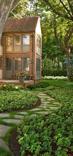 Lovely landscaping ☛ I like this idea...a path from the house to a pergola or another area in the yard.