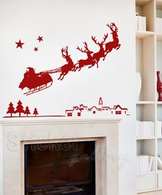 Santa flying over village - Wall Decal.