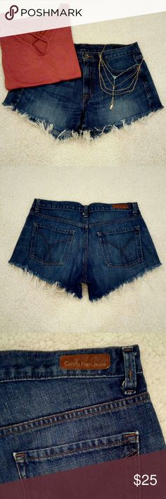 Calvin Klein Distressed Denim Shorts These super cute cutoff jean shorts are perfect for summer and go with everything! I've received many compliments! They are sexy with the fringe hem but still cover you up since they shorter on the outside edges with a small V split and longer in the middle. They are 100% cotton and do not stretch. I would recommend purchasing if you are true to a size 8/29 or a 6/28 for a slightly roomier fit. I love these and wish I didn't have to sell them, but they're…
