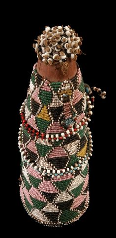 Africa | Fertility doll from the Sotho people of Lesotho.  Wood core, covered in beadwork | ca. 1920 - 1928 // 71.1998.7.7