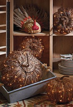 Enchant your harvest decor with the handcrafted appeal of our Pre-lit Grapevine Halloween Pumpkins.