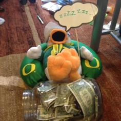 Puddles keeping his money tight while he sleeps at night. #theduckstore #yolo #oregon #oregoncheer #oregonducks #scoregon #goducks #ilovemyducks #autzen #eugene #503 #541 #pdx #portland #northwest #nike #skrill #paperchaser