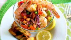 This tasty and refreshing ceviche can be prepared quickly, without fuss. It's ideal for serving as a starter or as the main dish when accompanied by tostones or platanutres (plantain chips.) I usually make this dish for my family on the weekends, when I feel like cooking something lighter.   I hope you enjoy my twist on this traditional Peruvian dish, which usually includes raw seafood marinated in lime juice. We've also discovered that white wine goes great with this recipe.