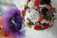 #Love the #unique #colors in this #buttonbouquet and also #loving the #tulle to give it that something #extra  #alternativebouquet #stunning #buttons #bright #alternative #wedding #bride #instaweddings #handmade #love #weddingparty #celebration  #bridesmaids #happiness #unforgettable #forever #ceremony #romance #marriage #weddingday #Australia #buttonbouquets #flowers  www.nicsbuttonbuds.com.au www.facebook.com/nicsbuttonbuds www.pinterest.com/nicsbuttonbuds www.instagram.com/nicsbuttonbuds…