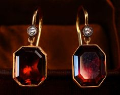 Antique garnet, diamond, and gold earrings, Octagonal garnets, set in 22 karat gold, suspended from 14 karat gold ear wires, each set with a diamond just above the suspension loop.