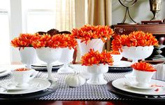 Milk glass with orange flowers and understated runner, modern yet festive
