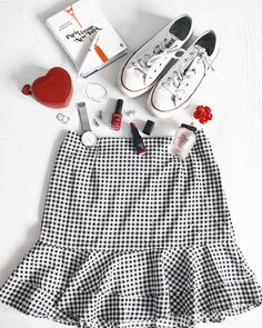 Flatlay with checkered skirt