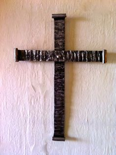 Classic texturized and riveted cross.