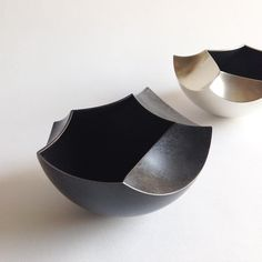 By Ane Christensen. Silver, painted copper.