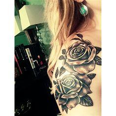 Rose tattoo on the shoulder