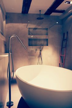 Bring Ibiza to your relaxing bathroom with this exquisite modern freestanding Corian bathtub SALINAS by #COCOON & Robust Inox floor mounted bath mixer by #COCOON / Dutch designer brand byCOCOON.com / All #COCOON bathroom taps are both available via inoxtaps.com and via byCOCOON.com / Bathroom design by COCOON project Amsterdam / Badkamer ontwerp & verbouwing byCOCOON.nl