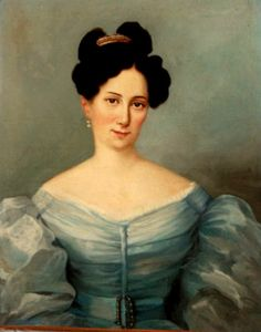 The exaggerated hair styles of the 1830s were often back up with mantilla style combs