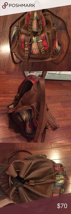NWT brown faux leather &plaid Under 1 Sky backpack Never used/worn, NWT. Brown faux leather backpack with plaid. Two large side Zipped pockets with plaid on them. Inside: one zipped compartment and two pockets. Two straps come down in front and attach to a magnetic metal buttons. And a compartment in the front Under One Sky Bags Backpacks