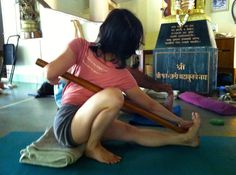 Marichyasana I with a stick for twist and alignment; Iyengar Yoga. At RIMYI, Pune.
