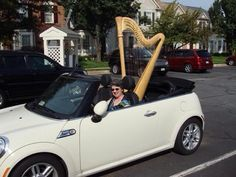Here's something you don't see everyday, a MINI Convertible with a harp in it's backseat. #Cargo #Harp