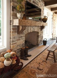A stone fireplace and wood mantle add a charming touch to this living room. The post A stone fireplace and wood mantle add a charming touch to this living room. appeared first on Decoration. Rustic Fireplaces, Home Fireplace, Fireplace Remodel, Fireplace Design, Fireplace Ideas, Stone Fireplaces, Rustic Mantle, Mantel Ideas, Rustic Fireplace Mantle
