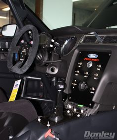 Interior of the 2014 Boss 302S, complete with roll cage, one RECARO leather seat, and much more....