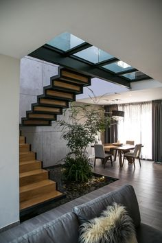Fill out your info to learn more :) Click the photo to see our website~! ❗️Floor skylights, floating stairs and an earth aesthetic? What's there not to love about this architectural design? Staircase Design Modern, Home Stairs Design, Interior Stairs, Modern House Design, Stairs Architecture, Interior Architecture, Interior Garden, Home Interior Design, House Stairs