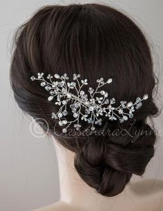 You will love this stunning bridal hair comb. Dozens of Preciosa crystal beads, rhinestones and ivory freshwater pearls are hand-wired into this delicate weddin
