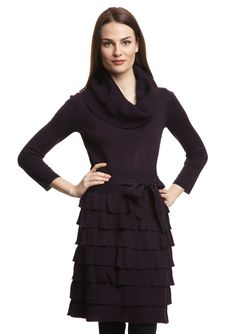 The ruffles add sweetness to this sweater dress