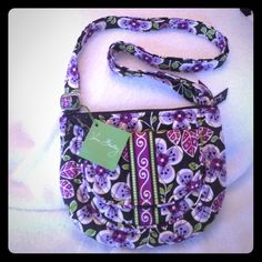Vera Bradley small crossbody BNWT This is BNWT. So cute and perfect purple print! Style is Lizzy Plum Petals, $47 new, please no trades or PP! Biggest discounts with bundles!  Vera Bradley Bags Crossbody Bags