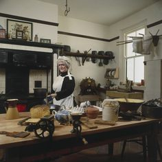 A Victorian kitchen display. This shows a reconstructed Victorian kitchen complete with a variety of Victorian kitchen appliances and the model of a cook preparing food, as seen in the Science Museum's Domestic Appliance gallery. http://www.ssplprints.com/image/218358/a-victorian-kitchen-display-this-shows-a