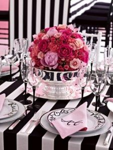 A pink rose short centerpiece goes great against a black and white palette. Really parisian and chic.<<<=== bet RED would look great here too