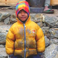 Nepalese child looks poor but this child extremely happy. Sometimes we miss beauty because we see through foggy glasses.