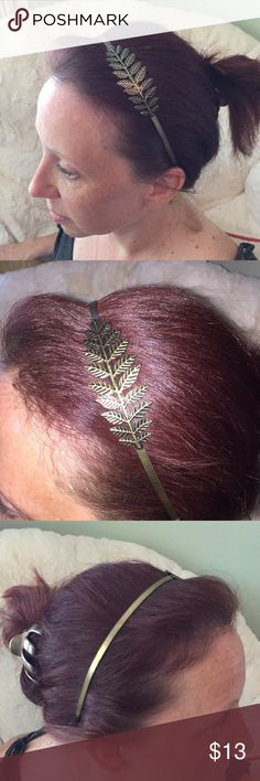 Gold headband with leaf detail Antique gold headband with gold leaf detail that can be worn on either side. Cloth at the ends provide a more comfortable fit and doesn't pull the hair. Accessories