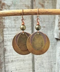 Antiqued copper and brass geometric drop earrings. The largest disc is the size of a quarter and the total hanging length is 2. Very light weight