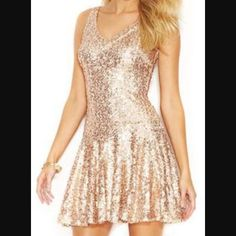 Rose gold Guess sequin dress Rose gold Guess sequin dress. Worn once for my birthday but perfect for New Years!!! Tag says size 6. I'm a size S & it fits perfectly! Guess Dresses Mini